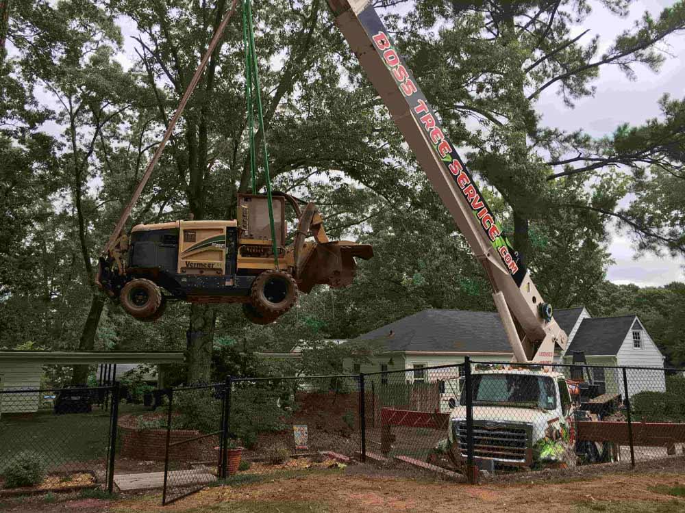 Crane lifting a tractor